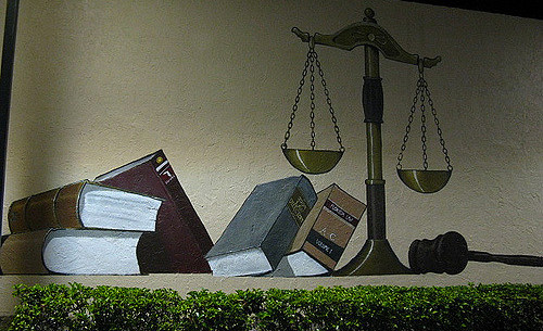 Clyde Robinson. Scales of Justice. Flickr CC.